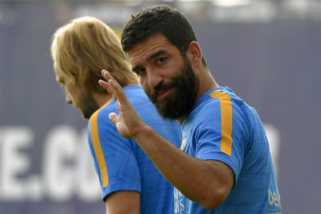 Arda Turan en un entrenamiento con el Barça